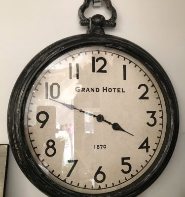 Black Distressed Wall Clock – Grand Hotel